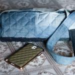 Quilted denim pillow bag decorated with blue beads