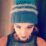 Turquoise beanie with openwork and furry details